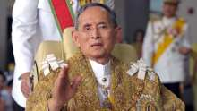 Thai King Bhumibol Adulyadej waves to we...Thai King Bhumibol Adulyadej waves to well-wishers after the royal ceremony for his 83rd birthday in Bangkok on December 5, 2010. the Thai king is the world's longest reigning monarch who is regarded as a demi-god by many Thais and considered a unifying force in a politically turbulent nation.  AFP PHOTO/Pornchai KITTIWONGSAKUL (Photo credit should read PORNCHAI KITTIWONGSAKUL/AFP/Getty Images)