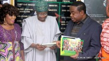 File photo of Minister of Communication, Lai Mohammed receiving a copy of a book from COSON Chairman, Tony Okoroji, as popular gospel singer, Kenny Saint Best, looks on during a courtesy visit to the Minister in Abuja on Thursday, November 24, 2016.