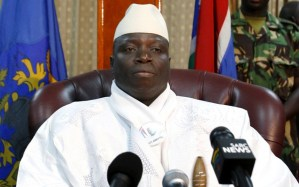 Gambian President Jammeh sits in his office during a news conference in Banjul...Gambian President Yahya Jammeh sits in his office during a news conference in Banjul, after election results announced him the winner of presidential polls, September 23, 2006. Tens of thousands of people crammed onto Gambia's tiny island capital Banjul on Saturday as Jammeh threw a massive beach party to celebrate his re-election for a third term. REUTERS/Finbarr O'Reilly (GAMBIA)