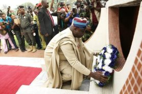 Ambode laying wreath