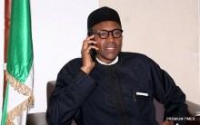 President Muhammadu Buhari making a call