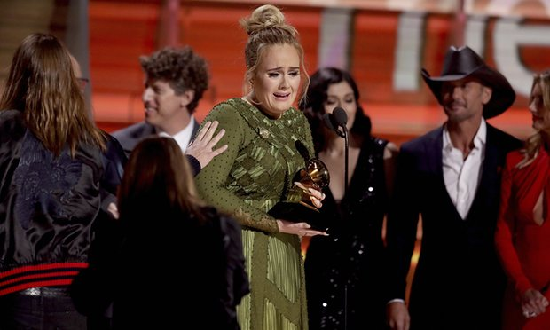 Emotional Adele receiving award at the 59th annual Grammy Awards on Sunday, February 12 [Photo Credit: theguardian.com]