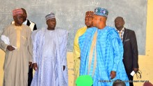 Gov Shettima (right) speaking with Borno's Head of Service, Barrister Yakubu Bukar ‎(middle)  at Lamisula Primary and Junior Secondary School in Maiduguri on Wednesday