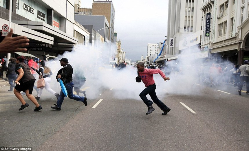South Africa Police fire Tear gas at Immigrants