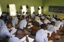 Students writing exams used to illustrate the story, Civil society