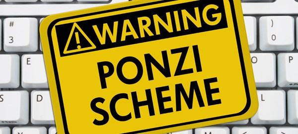 Ponzi Scheme Warning Sign,  A yellow sign with the words Ponzi Scheme on a keyboard