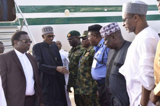 Buhari_arrives_from_London_4