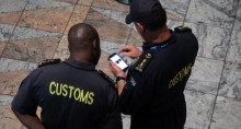 Customs officials at the Tambo International Airport, Johannesburg [Photo Credit: Raw Story]