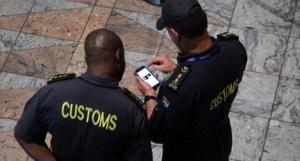 Customs officials at the Tambo International Airport, Johannesburg [Photo Credit: Raw Story]