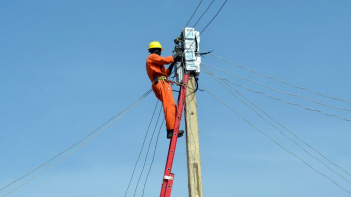 Meters being pole-mounted by JEDC