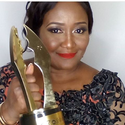Ebele Okaro- Onyiuke poses with her AMVCA plaque