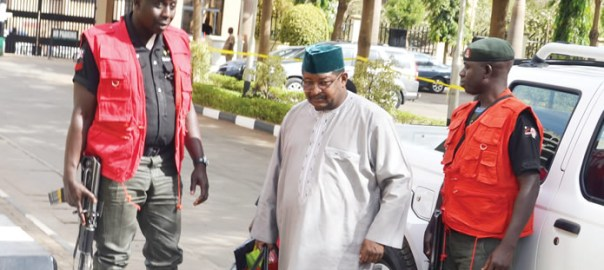 Ex-NNPC boss, Andrew Yakubu in company of security operatives. {Photo: Punch]