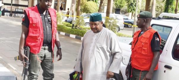 Ex-NNPC boss, Andrew Yakubu in company of security operatives. {Photo: Punch]