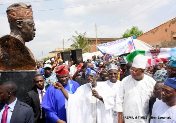 L-R: Lagos State Governor, Mr. Akinwunmi Ambode; Asiwaju Bola Ahmed Tinubu; Senator Ibrahim Kazure (Jigawa State); Senator Isiaka Adeleke (Osun State); Senator Ganiyu Solomon during the unveiling of Asiwaju's statue to commemorate the commissioning of the newly built Aboru-Abesan Link Bridge and adjourning roads in Church Street, Giwa Street, Victor Fagbemi Road, Ogunfayo Road, Ogundare Street, Salami Kazeem Street in Alimosho Local Government, Lagos, on Wednesday, March 29, 2017.