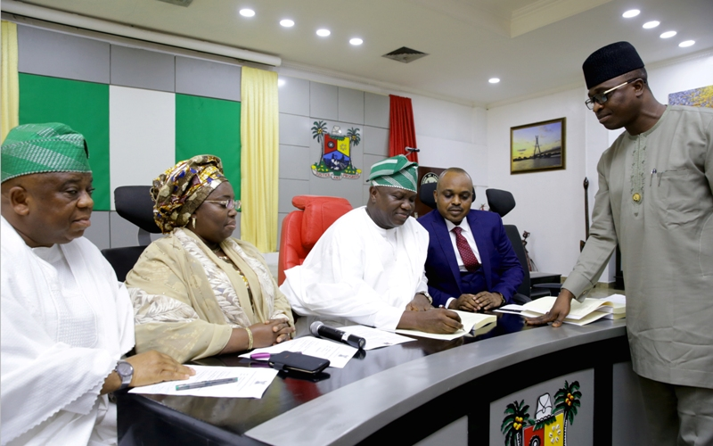 Lagos State Governor, Mr. Akinwunmi Ambode (middle), signing the Environmental Management and Protection bill into Law, at the Banquet Hall, Lagos House, Ikeja, on Wednesday, March 1, 2017.  (L-R) With him are Commissioner for the Environment, Dr. Babatunde Adejare; Deputy Governor, Dr. (Mrs) Oluranti Adebule; Chairman, House Committee on Environment, Hon. Dayo Fafunmi and Special Adviser to the Governor on Civic Engagement, Mr. Kehinde Joseph.