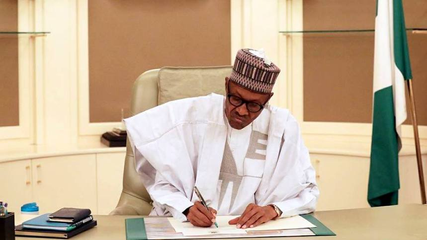 Billedresultat for buhari signing in his office