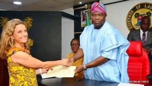 Lagos State Governor, Mr. Akinwunmi Ambode (right), congratulating the Chairman, Board of Arts & Culture, Mrs. PollyAlakija (left) while Acting Head of Service, Mrs. Folasade Adesoye (2nd right) watches during the inauguration of the Board at the Conference room, Lagos House, Ikeja, on Wednesday, April 12, 2017.