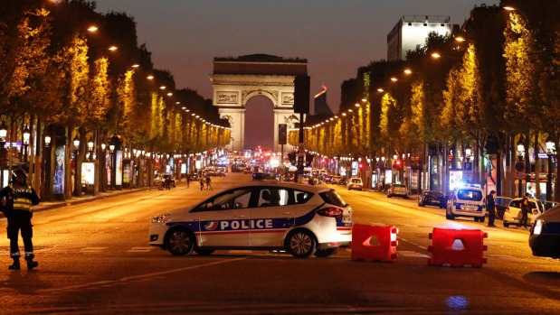 Police secure the Champs Elysees after one policeman was killed and another wounded in a shooting [Photo Credit: Stuff]