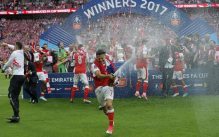 Alexis Sanchez pops champagne in celebration of FA cup victory [Credits: The Guardian]