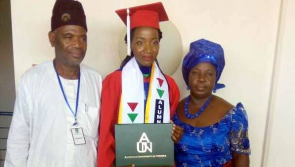 Ms. Onuigbo (MIddle) with her 'parents'