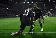 Batshuayi celebrates with Moses. Photograph: Dylan Martinez/Reuters [Photo Credit: The Guardian]