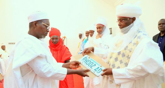 Waziri Adamawa and former Vice President, Atiku Abubakar being presented with his new car plate number RH 002 AD as the number two in hierarchy to the Lamido Adamawa by the Acting Secretary of Adamawa Emirate Council, Alh. Halilu Kawu when members of the Council and others paid homage to the new Waziri, at his residence in Yola, Adamawa State over the weekend.
