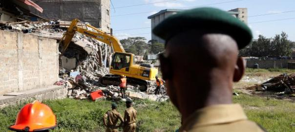 Emergency personnel work at the scene after a building collapsed in a residential area of Nairobi, Kenya June 13, 2017. REUTERS/Baz Ratner