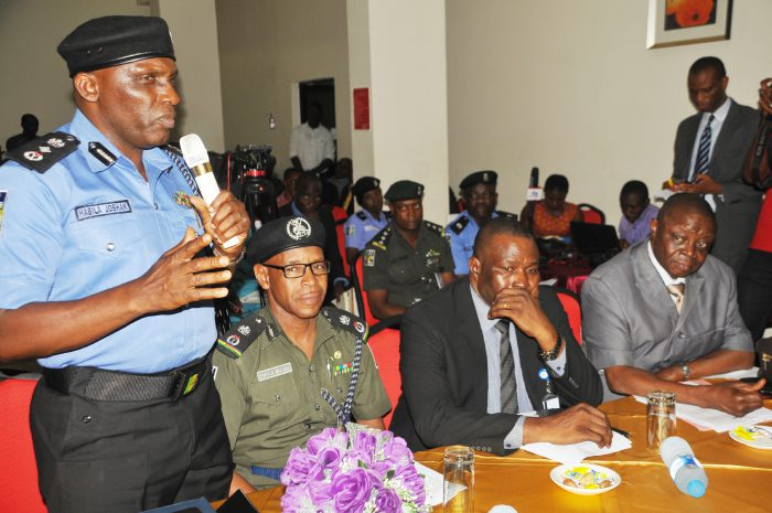"""From left: Representative of the Inspector-General of Police, DIG Joshak Habila; Commissioner of Police, Explosive Ordinance Department, CP Chika Maidama; Commissioner of Police, Interpol, CP Olushola Zubairu; and representative of the Acting Chairman, Economic and Financial Crime Commission (EFCC), Mr Emmanuel Adegboyega, during the launch of """"Effective Communication and Public Relations for Nigeria Law Enforcement Agencies"""", in Abuja on Tuesday (6/6/17). 03058/6/6/2017/Anthony Alabi/BJO/NAN"""