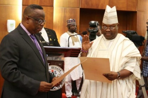 Ademola Adeleke swearing in administered by the Clerk of the Senate, Nelson Ayewoh