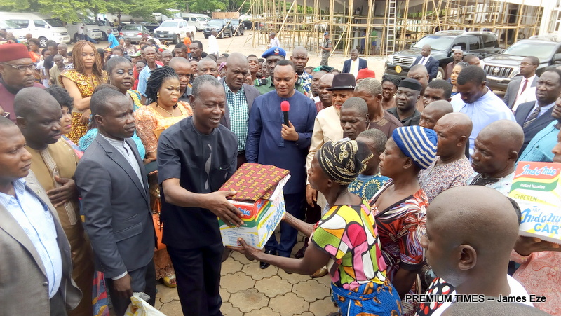 Governor David Umahi, represented by his deputy, Dr. Eric Kelechi Igwe(with mic) supervising the distribution of food and other items to the victims of the war torn Ogiri in Afikpo South council area of the state.