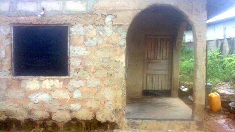 Baba Tolu's house, the cemented part indicates where he was buried.