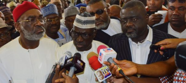 Caretaker committee chairman of PDP, Sen. Ahmed Makarfi speaking to newsmen after Supreme Court sitting in Abuja on Wednesday (12/7/17) sacked the National Chairman of the opposition of the, Sen. Ali Modu Sheriff. With him are Sen. Ben Obi (L) and Rep. Jones Onyereri.03460/11/7/2017/Ernest Okorie/BJO/NAN