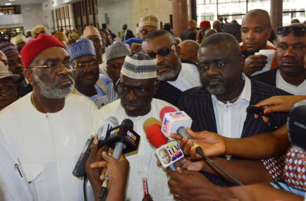Caretaker committee chairman of PDP, Sen. Ahmed Makarfi speaking to newsmen after Supreme Court sitting in Abuja on Wednesday (12/7/17) sacked the National Chairman of the opposition of the, Sen. Ali Modu Sheriff. With him are Sen. Ben Obi (L) and Rep. Jones Onyereri. 03460/11/7/2017/Ernest Okorie/BJO/NAN