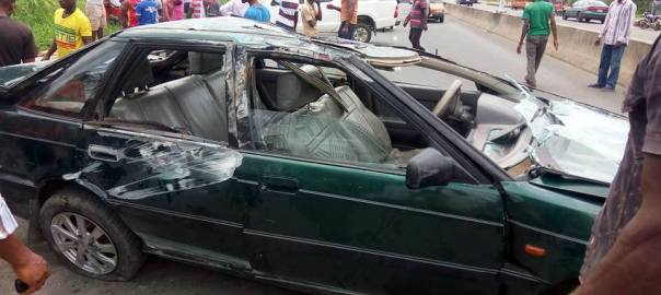 The scene of the car crash along Aka-Nung Udoe Road, Ibesikpo-Asutan, Akwa Ibom State [Photo credit: Aniefiok Ekwere]