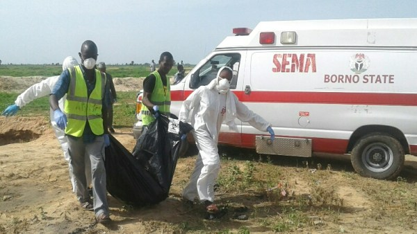 Officials of Borno State Emergency Management Agency evacuating remains of two suspected suicide bombers who died during an attack on Mammanti village on the outskirt of Maiduguri on Monday (17/7/17). Eight persons were killed and 15 others wounded in the attack. 03573/17/7/2017/Rabiu Sani/BJO/NAN