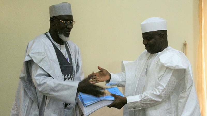 Chairman of the committee, Ambassador Shehu Wurno presenting the committee's report to the governor, Aminu Tambuwal