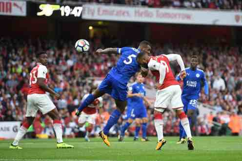 Alexandre Lacazette heads in the opening goal of the season. Photograph: Michael Regan/Getty Images