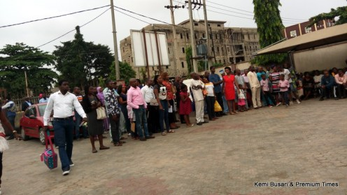 Applicants in standing positions in Alausa office