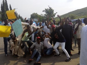 Pro-Buhari supporters celebrating as they await the his return