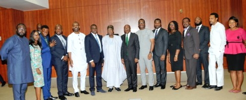The Minister of Information and Culture, Alhaji Lai Mohammed, and the Governor of the Central Bank of Nigeria, Mr. Godwin Emefiele, in a group photograph with stakeholders in the Creative Industry, during a visit to the CBN Governor in Abuja on Tuesday.