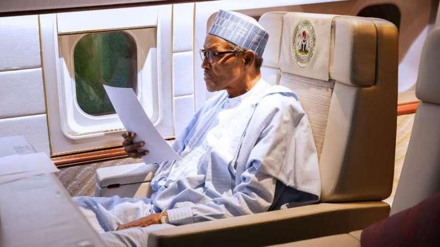 President Buhari reviewing a Speech draft.