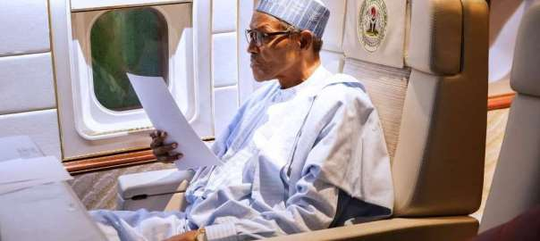 President Buhari reviewing a Speech draft.