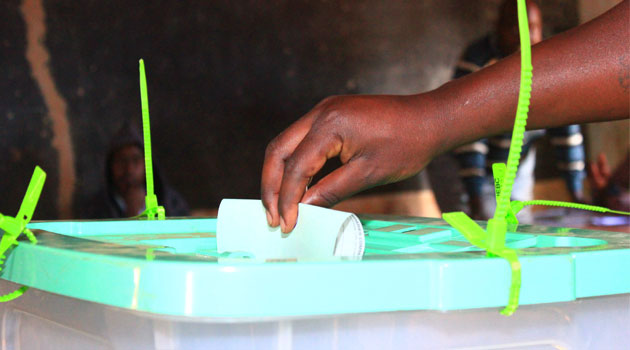 A person casting his vote used to illustrate the story.