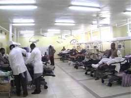 Medical Doctors (health workers) attending to patients used to illustrate the story health