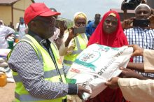 Executive Secretary of the State Emergency Management Agency, Dr. Danlami Rukujei presenting ieam to one of the IDPs