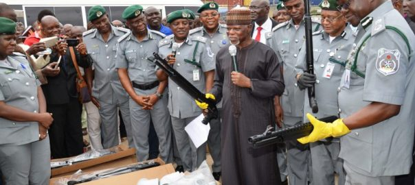 File photo of Comptroller-General of Nigerian Customs Service retired Col. Hameed Ali  (3rd R) and his men display some of the 470 pump action rifles smuggled into the country, which were seized 10 days after a similar seizure from Turkey, in Lagos on Thursday (21/9/17). 05077/21/9/2017/Wasiu Zubair/TA/BJO/NAN