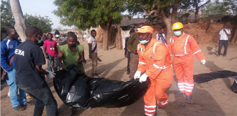 NEMA officials clearing the bomb site which illustrates the story. [Photo credit: Peace Ben Williams Blog]