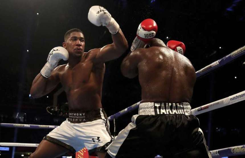 Anthony Joshua knocks down Takam to retain IBF title [Photo credit: The Edwardsville Intelligencer]