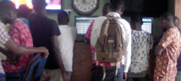 Bettors inside a betnaija shop in Lagos Island