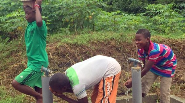 Children of Ikot Nkpenne community, in Nsit Atai Local Government Area of Akwa Ibom State, fetching water from the borehole constructed by UNICEF and EU [Photo Credit: Nike Adebowale]
